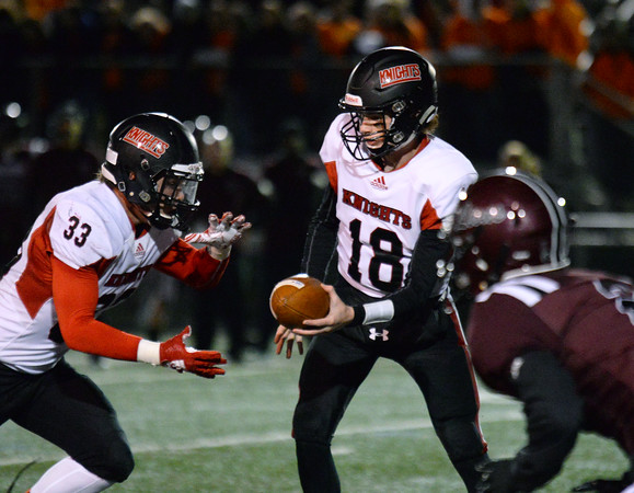 CARL RUSSO/Staff photo North Andover's quarterback, Peter Radulski hands the bal off to running back Sebastian Vente. North Andover defeated Chelmsford 22-20 in Friday night football action.  10/11/2019