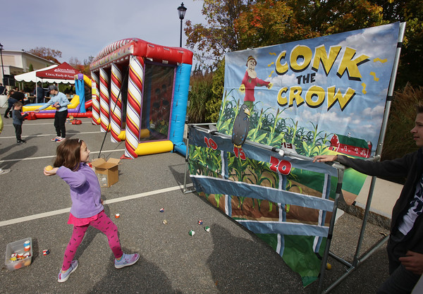 """MIKE SPRINGER/Staff photo<br /> Six-year-old Madison Todisco of Derry tries her hand at """"Conk the Crow"""" during the annual Toscana Fest on Sunday at the Tuscan Kitchen and Market in Salem, New Hampshire. The event included food, games and exhibits, with proceeds going to Lazarus House Ministries.<br /> 10/13/2019"""