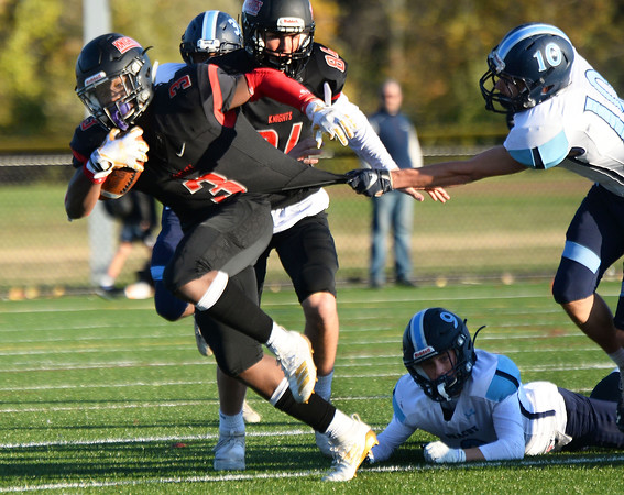 CARL RUSSO/Staff photo North Andover's Ricky Brutus breaks all tackles. North Andover defeated Dracut 41-14 in football action.10/18/2019