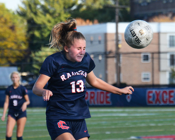 CARL RUSSO/Staff photo Central captain, Addison Jaromin heads the ball Central Catholic defeated Andover 3-0 in girls soccer action Monday afternoon. 10/14/2019