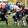 CARL RUSSO/Staff photo North Andover, from left, captain Shaun Nichols, Jake Wolinski and Jadynn Mencia tackle Dracut runner. North Andover defeated Dracut 41-14 in football action.10/18/2019