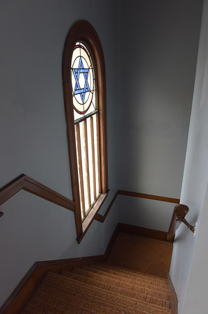 TIM JEAN/Staff photo<br /> <br /> A stained glass windows facing the entrance seen from the balcony of the Congregation Ansha Sholum on Hampshire Street in Lawrence. The congregation is celebrating its 100 year anniversary this weekend.   10/22/19