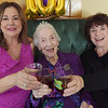 TIM JEAN/Staff photo<br /> <br /> Celebrating her 101st birthday with a toast is Gelsomina Palese, center, of Methuen, with her daughters Linda Corneau, left, and Donna Hopler, with balloons and a birthday cake. 10/19/19