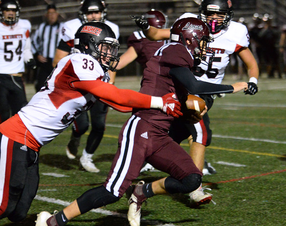 CARL RUSSO/Staff photo North Andover's Sebastian Vente comes in from behind to sack Chelmsford quarterback, Brett Baker. North Andover defeated Chelmsford 22-20 in Friday night football action. 10/11/2019