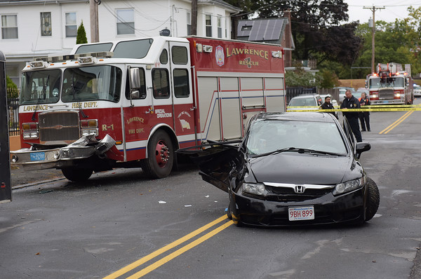 TIM JEAN/Staff photo<br /> <br /> A black Honda crashed with a Lawrence Fire truck Saturday morning at the intersections of Bailey and Phillips St., Saturday morning.    10/12/19