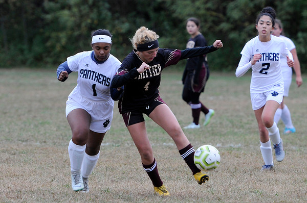TIM JEAN/Staff photo<br /> <br /> Whittier's Allison Flangan, right, fends off PMA's Chanelle Hiche, left, to control the ball, during a girls soccer game. Whittier Tech defeated Presentation of Mary Academy 3-0.    10/3/19