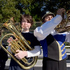 TIM JEAN/Staff photo<br /> <br /> Middle school students Gavin Cleary, left, and Fin Scully, both 13, perform along side of Andover High School Marching Band member of Max Remes, 15, right, during a football game at the high school.   10/5/19