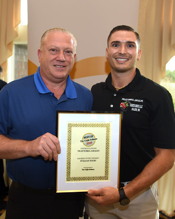 """RYAN HUTTON/ Staff photo <br /> Trattoria Amalfi owner Gerardo Cammarano, left, and his son Gerardo Cammarano Jr., right, accept their Best of the Eagle-Tribune Award for """"Best Italian Food"""" during the awards breakfast at the Atkinson Country Club on Wednesday morning."""