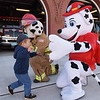 TIM JEAN/Staff photo<br /> <br /> Evan Defriesse, 2, runs towards the fire departments mascots to give them a hug, during the second annual Methuen Day in downtown Methuen in coordination with the Methuen Fire and Police Departments Open Houses.   10/5/19