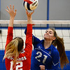 CARL RUSSO/Staff photo. Salem's Ecaterina Rojco spikes the ball over the net. Salem Blue Devils were defeated by the Bedford Bulldogs three games to one in volleyball tournament action Thursday night. 10/31/2019