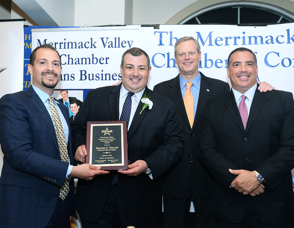 CARL RUSSO/Staff photo From left, Merrimack Valley Chamber assistant vice president, Michael Bevilacqua, Emerging Leader Award recipient, Patrick Driscoll, owner of Driscoll Funeral Home, Governor Charlie Baker and chairman of the Merrimack Valley Chamber, Salvatore Lupoli.    <br />  <br /> The Merrimack Valley Chamber of Commerce held their annual 2019 dinner and award ceremony. The event, held at DiBurro's Function Facility  Wednesday night, featured Massachusetts Governor, Charlie Baker as the guest speaker. 10/02/2019