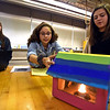 RYAN HUTTON/ Staff photo<br /> Woodbury Middle School eighth graders Angelina Hajjare, 13, Kyleigh Viveiros, 13, and Stevie Chance, 13, discuss the model home they built with the goal of it insulating itself using solar rays and not it's own heat source.