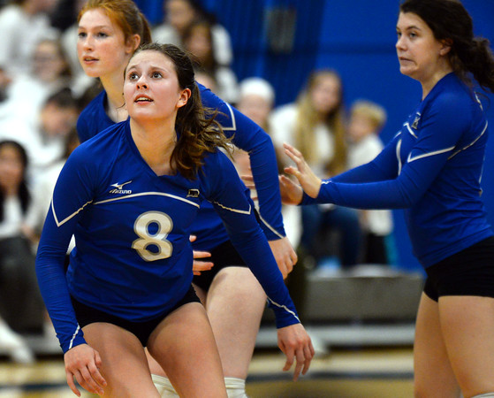 CARL RUSSO/Staff photo. Salem captain, Kacie Blanchet and her teammates struggle to win another game. Salem Blue Devils were defeated by the Bedford Bulldogs three games to one in volleyball tournament action Thursday night. 10/31/2019