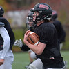 TIM JEAN/Staff photo<br /> <br /> North Andover quarterback Peter Radulski runs with the ball as the teams runs condition drills during practice Tuesday afternoon.   10/22/19