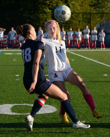 CARL RUSSO/Staff photo Andover's Ava Trapp fights for  the ball with Central captain, Kaleigh Lane, Central Catholic defeated Andover 3-0 in girls soccer action Monday afternoon. 10/14/2019