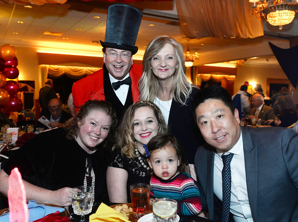 CARL RUSSO/Staff photo. The Ringmaster for the evening, Thomas Connors, President and CEO of American Training poses for a photo with his family. His wife, C J; daughter, Paige, seated left, son Tommy Connors and his wife Erica and their daughter Delia, two years old. <br /> <br /> American Training celebrated its 40th Anniversary and presented Ray DiFiore of Methuen with the 2019 Life Matters Award during the 18th Annual Life Matters Awards Gala and Greatest Show On Earth circus theme celebration on October 25 at the Andover Country Club. DiFiore was honored with the Life Matters Award for his dedicated career in public service in Lawrence and Methuen, and his commitment to American Training. <br /> <br /> Several other people and businesses were also honored with awards for Outstanding Partners, Vendor of the Year and Company of the Year. <br /> <br /> American Training is a non-profit organization based in the Merrimack Valley that provides housing, education, training & support services to people with disabilities, youth at risk & adult learners who are looking for a pathway towards a more meaningful life. 10/25/2019