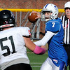 TIM JEAN/Staff photo<br /> <br /> Salem quarterback Kaleb Bates throws a pass under heavy pressure from Bedford's Zachary Barnard during a football game at Trinity Stadium in Haverhill.   10/19/19