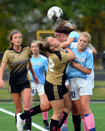 CARL RUSSO/Staff photo Haverhill's Taylor Bruneau battles to head the ball with several Dracut defenders. Haverhill defeated Dracut 2-1 in girls soccer action Tuesday afternoon. 10/8/2019