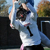 TIM JEAN/Staff photo<br /> <br /> Salem's Michael Ference makes a catch over Bedford's Solomon Sanchez and scores a touchdown. Salem defeated Bedford 34-3 at Trinity Stadium in Haverhill.   10/19/19