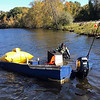 PHOTO COURTESY ROCKY MORRISON<br /> A team from the Clean River Project uses an inflatable pontoon and a diver to raise a Lawrence Community Boating Program boat from the bottom of the Merrimack River on Monday morning after it sank during last week's nor'easter.