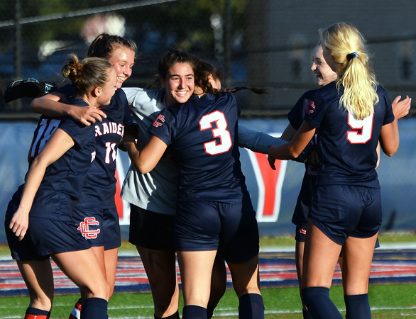 CARL RUSSO/Staff photo Central's senior goalkeeper, Kat DeSimone is congratulated by her teammates after the game. From left, captains Kaleigh Lane and Samantha Andrews, Lorelie Murphy, (3), Madelyn Zubiel and Elizabeth Dankert (9).  Central Catholic defeated Andover 3-0 in girls soccer action Monday afternoon. 10/14/2019