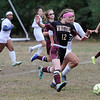 TIM JEAN/Staff photo<br /> <br /> Whittier's Cat Schwartz break away from the PMA defense and scores one of her three goals, during a girls soccer game. Whittier Tech defeated Presentation of Mary Academy 3-0.    10/3/19