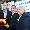CARL RUSSO/Staff photo From left,  Massachusetts Governor Charlie Baker is presented his award from the chairman of the Merrimack Valley Chamber of Commerce, Salvatore Lupoli and Merrimack Valley Chamber president and CEO, Joseph Bevilacqua.      <br /> <br /> The Merrimack Valley Chamber of Commerce held their annual 2019 dinner and award ceremony. The event, held at DiBurro's Function Facility  Wednesday night, featured Massachusetts Governor, Charlie Baker as the guest speaker. 10/02/2019