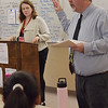 TIM JEAN/Staff photo<br /> <br /> North Andover Middle School teacher Patrick McGravey, right, introduces Melissa Murphy-Rodrigues, North Andover Town Manager to his eight grade students durning a Civics in Action Speaker Series.     10/11/19