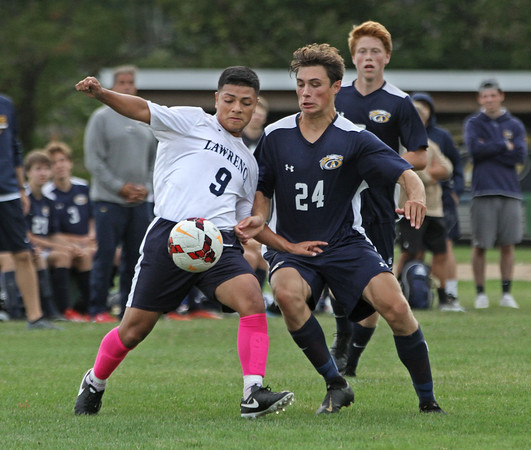 MIKE SPRINGER/Staff photo<br /> Lawrence's Samuel De Amorin, left, prepares to make a shot on goal as Anthony Previte of Andover applies defensive pressure during varsity soccer action Tuesday at Andover.<br /> 10/01/2019