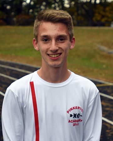 RYAN HUTTON/ Staff photo<br /> Pinkerton Academy cross country runner Ethan Charles.