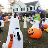 CARL RUSSO/Staff photo. Dave and Sabrina Alberg of Danville with their children, Richie, 10, Gabriella, 7 and Ameila, 5 in front of their house. Richie Alberg, a 10 year old boy with autism is passionate about inflatable decorations. For his birthday he asks for them, for Christmas he asks for them. Last year he made the community page for the town and he thought it was the best thing ever. This year as his mom struggled with Cancer, his only wish was to make the newspaper or the news. He said it was ok if he didn't get anymore this year as he got to keep his mother. 10/24/2019