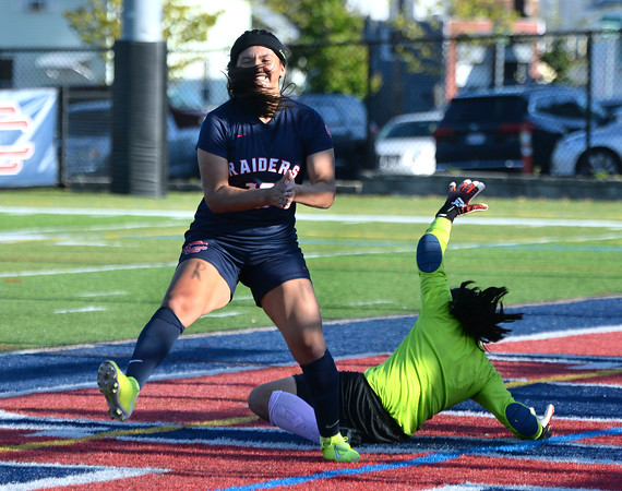 CARL RUSSO/Staff photo Central's Adrianna Niles celebrates after scoring the first goal of the game on the rebound of her penalty kick. Andover's goalkeeper, Izzy Shih (seen here) made the save on Niles penalty kick but couldn't on the rebound kick. Central Catholic defeated Andover 3-0 in girls soccer action Monday afternoon. 10/14/2019