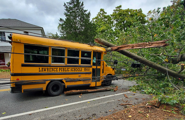 Photo courtesy of Yahaira Rosa<br /> A Lawrence Public Schools bus sits trapped under a fallen tree and power lines on North Street at Chandler Road on Thursday morning. Only the driver was onboard at the time and escaped any serious injury.
