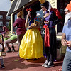 TIM JEAN/Staff photo<br /> <br /> Brayden Lopez, 2, of Derry, dressed as a Oompa-Loompa, looks over the Snow White themed costumes from workers at the Grind Rail Trail Cafe as they pass out candy to children during the Downtown Business Trick-or-Treating in Derry.  10/26/19