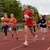 TIM JEAN/Staff photo<br /> <br /> Girls from Londonderry's three elementary schools race around the track then into the woods during the annual town wide cross country races at Londonderry High.    10/10/19