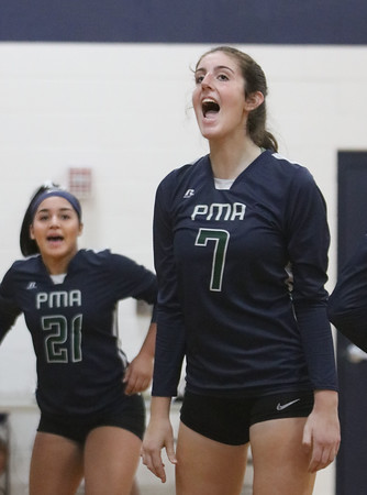 MIKE SPRINGER/Staff photo<br /> Sara D'Agostino, right, and Maia Munoz of Presentation of Mary celebrate a point during varsity volleyball play Thursday against Nashoba Valley Tech at Methuen.<br /> 10/24/2019