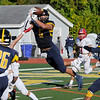 TIM JEAN/Staff photo<br /> <br /> Andover's Jackson McCarthy breaks up the pass against Central during a football game at Andover High School. Central won 41-10. 10/5/19