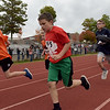TIM JEAN/Staff photo<br /> <br /> Boys from Londonderry's three elementary schools race around the track then into the woods during the annual town wide cross country races at Londonderry High.    10/10/19