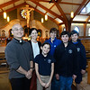 CARL RUSSO/Staff photo Fr. Jiwon Yoon, a new priest at St. Michael's Parish in North Andover with parishioners, from left Jean Masterson and her daughter Annie, a 5th. grader at St. Michael's School and Jess Cascio and her sons Caleb, 8th. grader and Jacoby, 6th. grader both at St. Michael's School. Fr. Yoon has been at St. Michael's since June of 2019. 10/15/2019