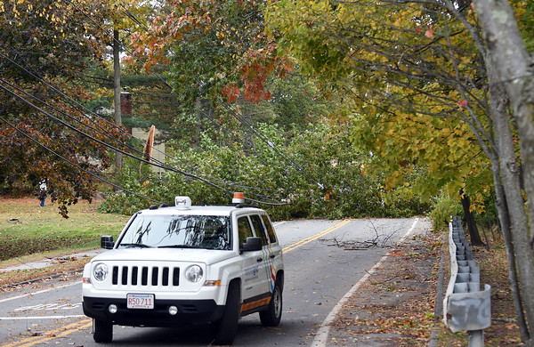RYAN HUTTON/ Staff photo<br /> A National Grid truck blocks the entrance of North Street near Chandler Road in Andover where a tree knocked power lines onto a Lawrence Public Schools bus and blocked the road on Thursday morning.