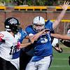 TIM JEAN/Staff photo<br /> <br /> Salem's Owen Gormley puts pressure on Bedford quarterback Joseph Mikol during a football game at Trinity Stadium in Haverhill.   10/19/19