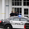 TIM JEAN/Staff photo<br /> <br /> Pelham police officers outside New England Pentecostal Ministries the scene of an active shooter situation inside the church on Bridge Street.   10/12/19