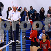 CARL RUSSO/Staff photo North Andover's Emma Staudt spikes the ball over Andover defenders. The North Andover Scarlet Knights played against the Andover Golden Warriors in volleyball action Monday night. 10/21/2019