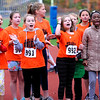 TIM JEAN/Staff photo<br /> <br /> Girls from Matthew Thornton Elementary School cheer on the boy runners during the annual town wide elementary school cross country races at Londonderry High.    10/10/19