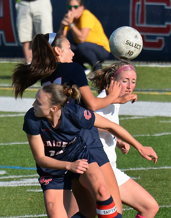 CARL RUSSO/Staff photo Central captain, Kaleigh Lane, front and her teammate Claudia Porto battle for the ball with Andover's Monique O'Toole. Central Catholic defeated Andover 3-0 in girls soccer action Monday afternoon. 10/14/2019
