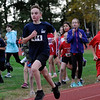 TIM JEAN/Staff photo<br /> <br /> South School's Sam Schreiner, left, sprints to win the boys  annual town wide elementary school cross country race at Londonderry High. North School's Broch St. Gelais, right, was a close second.    10/10/19