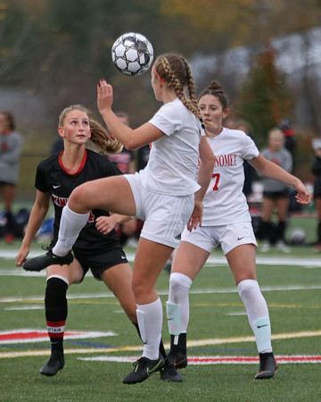 MIKE SPRINGER/Staff photo<br /> North Andover's Olivia Gotobed, left, competes for a loose ball with Charlotte Meixsell, center, and Victoria Simas of Masconomet during varsity soccer play Monday in North Andover.<br /> 10/28/2019
