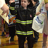 TIM JEAN/Staff photo<br /> <br /> Zac Park, 3, of Derry, dressed as a fireman waves to the judges as he walks in the Spooktacular Costume Parade & Contest in Veterans Hall Gymnasium in Derry.   10/26/19