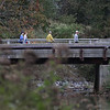 MIKE SPRINGER/Staff photo<br /> Hikers walk across the Central Street bridge during the 2nd Annual Andover Scramble on Sunday. <br /> 10/06/2019
