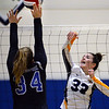 CARL RUSSO/Staff photo Andover's Marissa Kobelski keeps the ball in play as Methuen's Kate McDonnell defends. Andover defeated Methuen in the 5th. game of volleyball action at Andover high. 10/7/2019